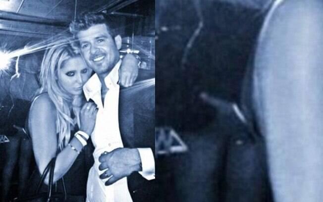 Robin Thicke foi pego na mão boba durante a premiação do VMA. o cantor, que é casado, apertou a bunda de uma fã na hora foto