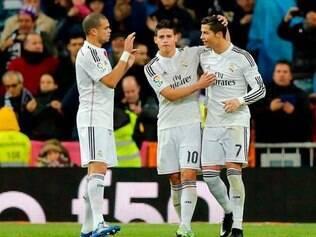 Em noite inspirada, português marcou três vezes e assegurou a liderança do time merengue