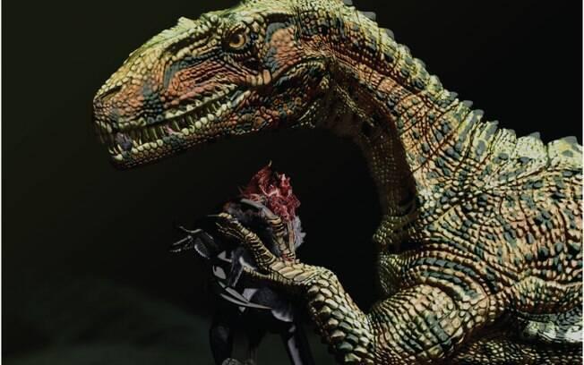 Concepção artística do Australovenator com uma presa: o novo espécime é aparentado com o T-Rex