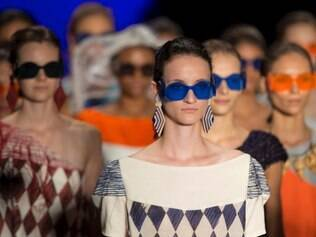Models wear creations from the Ronaldo Fraga Summer collection during the Sao Paulo Fashion Week in Sao Paulo, Brazil, Wednesday, April 2, 2014. (AP Photo/Andre Penner)