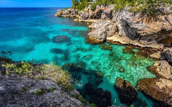 Negril, na Jamaica, oferece um dos litorais mais bonitos do mundo, e uma dica é ficar por lá para o pôr-do-sol