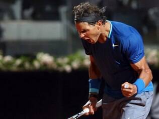 Spain's Rafael Nadal celebrates after winning a point during his match against France's Gilles Simon, at the Italian open tennis tournament in Rome, Wednesday, May 14, 2014. (AP Photo/Gregorio Borgia)