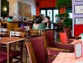 Vegetariano tem espaço com redes para o descanso após a refeição