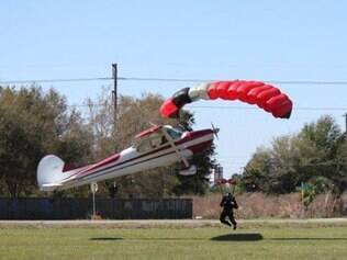 This photo released by the Polk County Sheriff's Office shows a plane getting tangled with a parachutist, Saturday March 8, 2014, at the South Lakeland Airport in Mulberry, Fla. Both the pilot and jumper hospitalized with minor injuries. (AP Photo/Polk County Sheriff's Office, Tim Telford) MANDATORY CREDIT