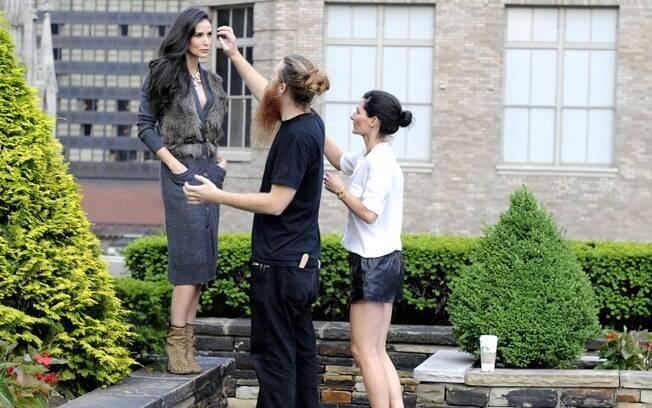 Demi Moore posa de modelo no Rockefeller Center em Nova York