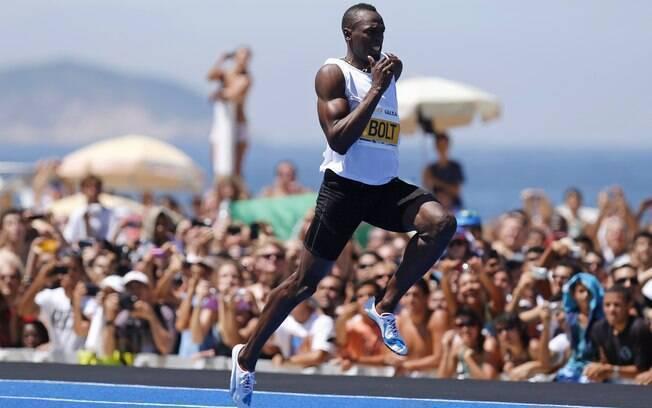 Usain Bolt correu na manhã deste domingo na  praia de Copacabana, no Rio de Janeiro