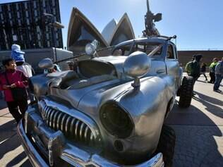 Visitors look at vehicles from the new Mad Max movie