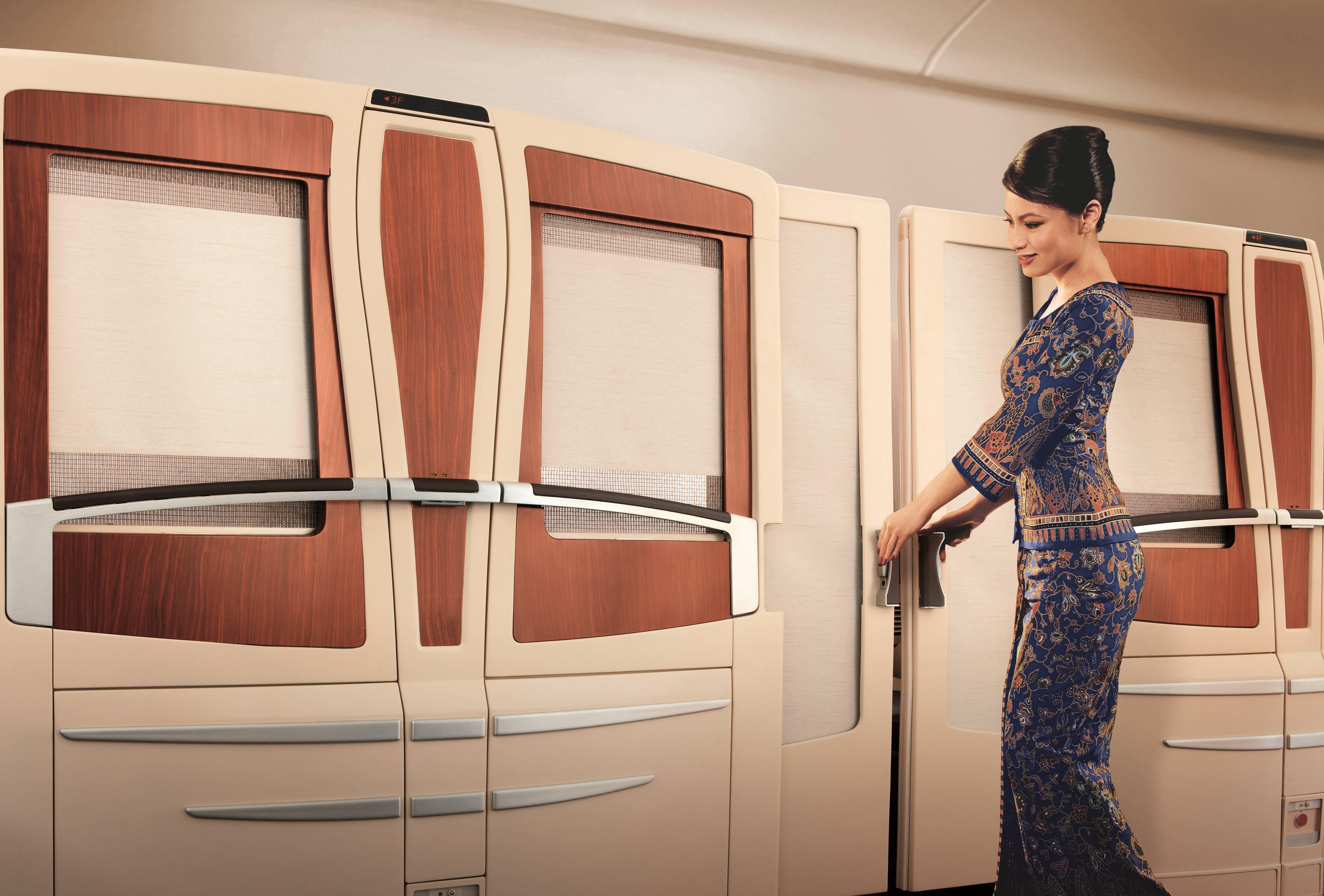 Outro diferencial da primeira classe da Singapore são as portas de correr para garantir a privacidade dos passageiros. Foto: Divulgação/Singapore Airlines