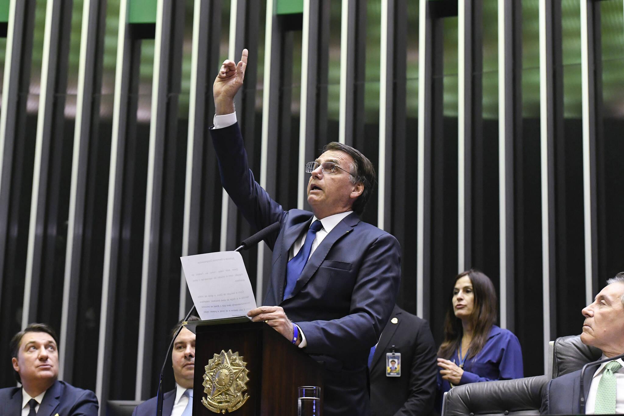 """""""Brasil acima de tudo, Deus acima de todos"""": lema de campanha foi repetido por Bolsonaro. Foto: Edilson Rodrigues/Agência Senado - 1.1.19"""
