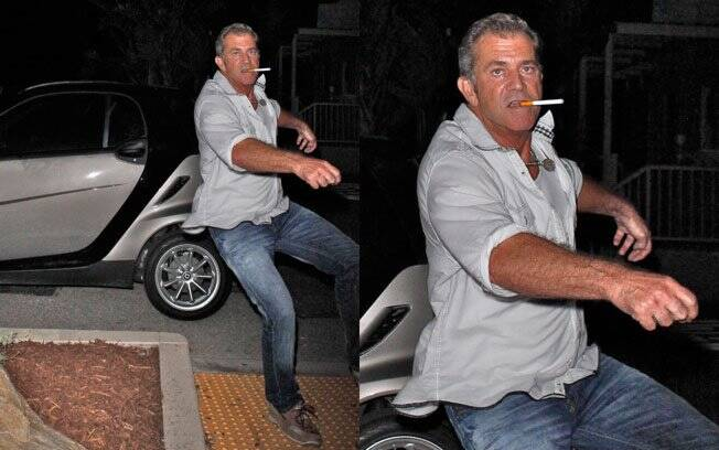 Visivelmente embriagado, Mel Gibson tenta agredir paparazzi e quase cai no chão