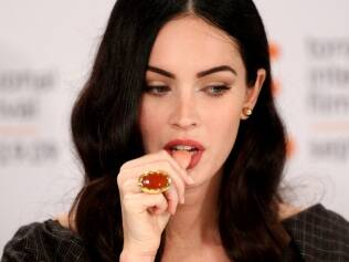 Rosto feminino e belos lábios, como os da atriz Megan Fox, são características que atraem os homens