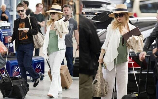 Durante sua passagem pela cidade de Buenos Aires, Argentina, Kate Hudson apostou na calça de linho branca, uma regata verde e um chapéu panamá