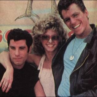 Jeff Conaway ao lado de John Travolta e Olivia Newton John no filme