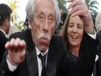 O ator Jean Rochefort brinca antes da sessão do documentário de Jean-Paul Belmondo. Foto: Reuters