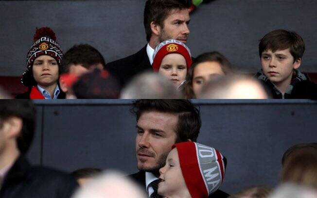 David Beckham e os filhos Romeo, Cruz e Brooklyn no jogo do Manchester United na noite desse sábado (12)
