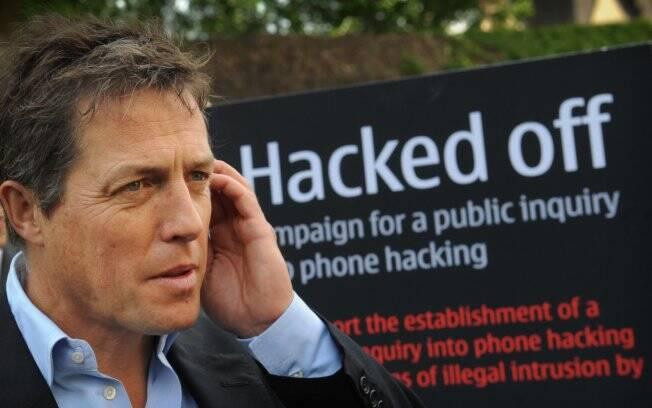 O ator britânico Hugh Grant em frente ao Parlamento em Londres, onde aconteceu uma reunião de emergência sobre o escândalo dos grampos (06/07)